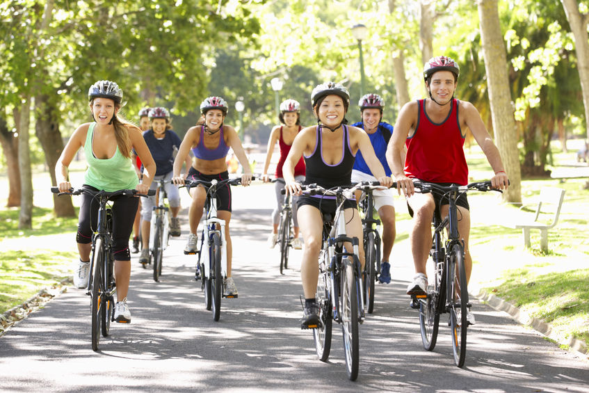 healthy young people riding bikes