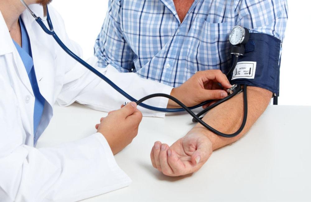 nurse taking a patient's blood pressure
